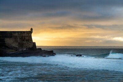 Detail of the Sao Juliao da Barra Fort with the waves breaking at Carcavelos, Oeiras, Portugal