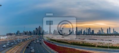 Obraz Dubai Skyline under Cloudy Sky, Dubai Downtown Residential and Business Skyscrapers, a view from Dubai Water Canal, Dubai, United Arab Emirates