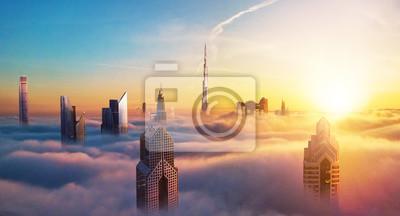 Obraz Dubaj zmierzchu widok zakrywający z chmurami śródmieście