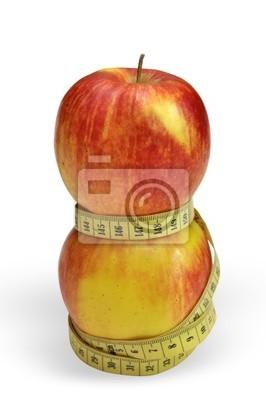 Dwa jabłka z pomiaru taśmę pomiędzy, jakby wskazujące talii