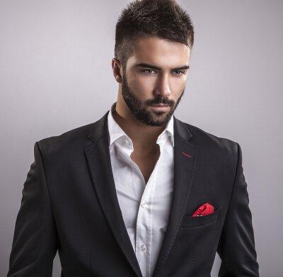 Obraz Elegancki młody przystojny mężczyzna. Portret studyjny mody.