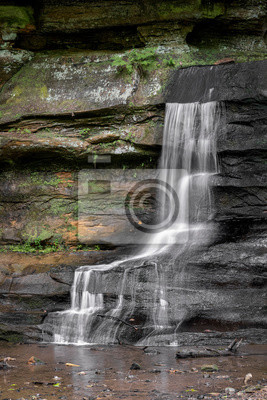 Ephemeral Cascade - In the rain, a small, unnamed waterfall flows down the sandstone wall of the gorge at Old Man's Cave in Hocking Hills State Park, Ohio.
