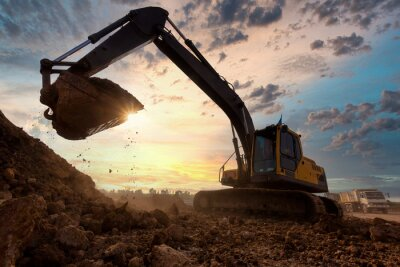 Obraz excavator at sandpit during earthmoving works in the construction site.