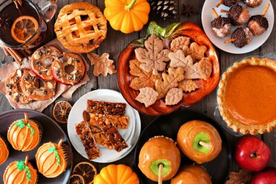 Obraz Fall desserts table scene with a mixture of sweet autumn treats. Top down view over a dark wood background.