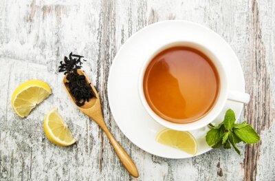 Obraz Filiżanka herbaty z cytryną i miętą