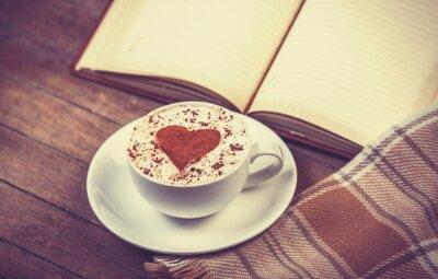 Obraz Filiżanka kawy i książki z szalikiem