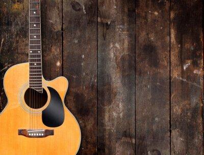 Obraz Gitara akustyczna na rustykalnym tle