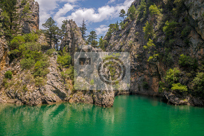 Green lake among rocks