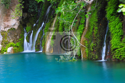 green stones and waterfall