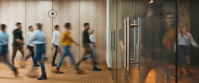 Obraz Group of office people walking at office open space. Team of business employees at coworking center. People at motion blur. Concept working at action
