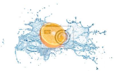Obraz half of fresh orange fruit in water splash