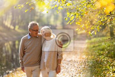 Obraz Happy senior couple in autumn park