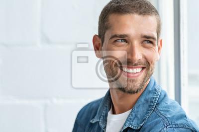 Obraz Happy smiling man looking away