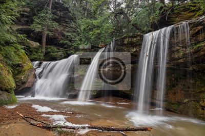 Hidden in the Hocking Hills - Hidden Falls is a waterfall in the Hocking Hills of Ohio that is partially obscured by a huge boulder and only flows well after heavy rains.
