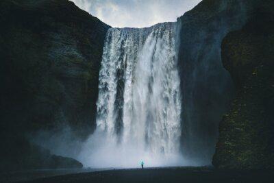 Obraz Hiker at gigantic Skogafoss waterfall in Iceland