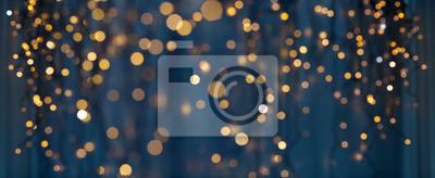 Obraz holiday illumination and decoration concept - christmas garland bokeh lights over dark blue background