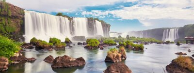 Obraz Iguazu waterfalls in Argentina, view from Devil's Mouth. Panoramic view of many majestic powerful water cascades with mist and clouds. Panoramic image of Iguazu valley with stones in water.