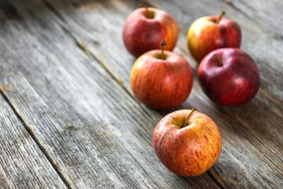 Obraz Jabłka na drewnianym tle