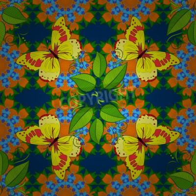 Jednolite kwiatowy wzór mandali w kolorze różowym, zielonym i turkusowym blado pomarańczowego kwiatu na niebieskim tle. Żółte buterflies z zielonymi liśćmi.