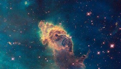Obraz Jet w Mgławicy Carina. Składa się z gazu i pyłu.