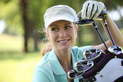 Obraz Kobieta na polu golfowym