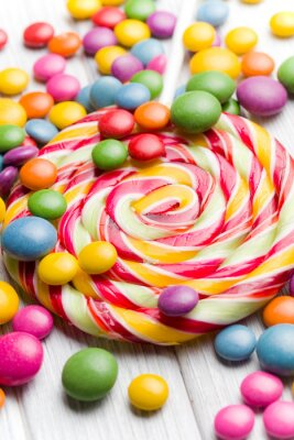 Obraz kolorowe cukierki i lizak