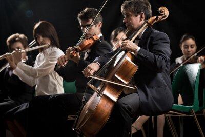 Obraz Koncert muzyki klasycznej: orkiestra symfoniczna na scenie