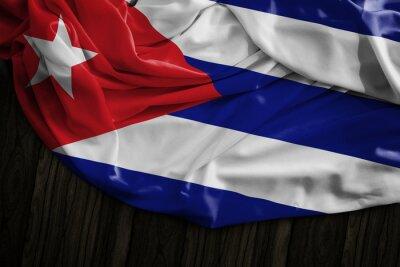 Obraz Kubańska flaga na drewnianym stole