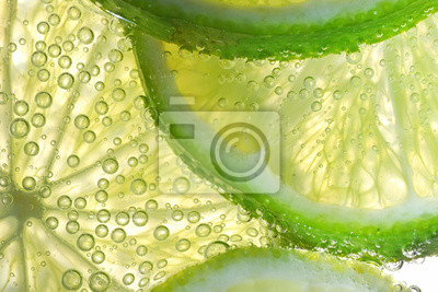 Obraz Lemon Slices In Water With Bubbles
