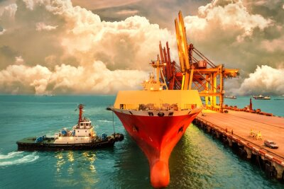 Obraz Logistyka i transport międzynarodowego kontenerowego ładunku statku z portami dźwigu most w porcie i wieczornym niebie dla logistycznego importu eksportowego tła i transportu przemysłu.