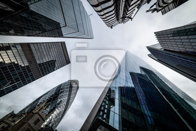 Obraz Low angle view of skyscrapers. Looking up perspective. Bottom view of modern skyscrapers in business district. Business concept of success industry