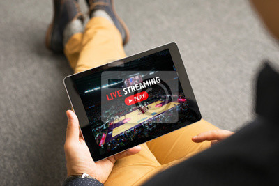 Obraz Man watching sports on live streaming online service