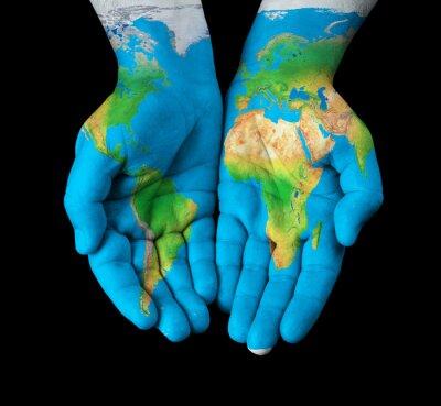 Obraz Mapa malowane na rękach przedstawiających koncepcję - Świat w naszych rękach