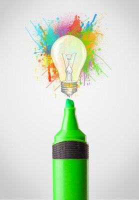 Obraz Marker close-up z kolorowymi plamami farb i żarówka