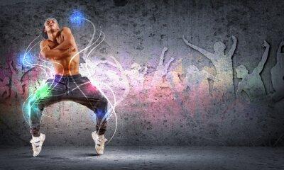 Obraz Młody mężczyzna tańczy hip hop z liniami koloru