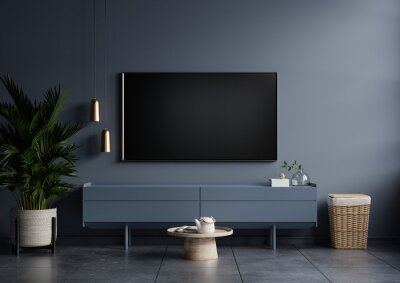 Obraz Modern interior of living room with tv on the cabinet on dark blue wall background.