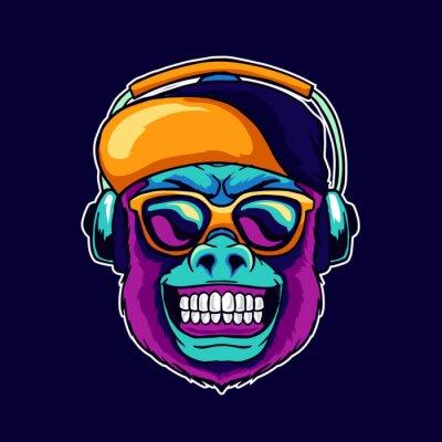 Obraz Monkey smile wear cool glasses and cap hat listening dope music on the headphone speaker vector illustration. Pop art color style animal gorilla head logo design for creative DJ sound producer studio.
