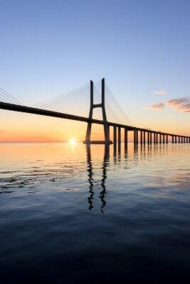 Obraz Most Vasco da Gama, wschód słońca w Lizbonie