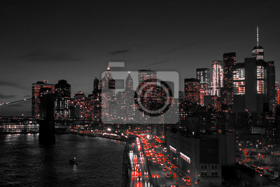 Obraz New York City black and white night skyline with red lights glowing in downtown Manhattan