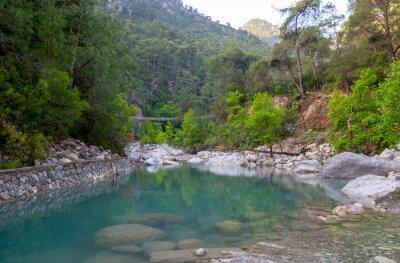 nice mountain lake with emerald water