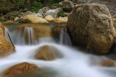 nice small waterfall on mountain river