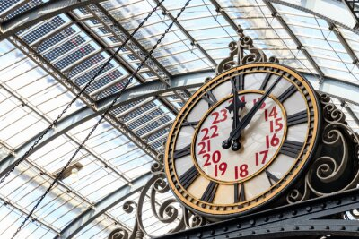 Obraz Old-fashioned style clock at Kings Cross train station in London