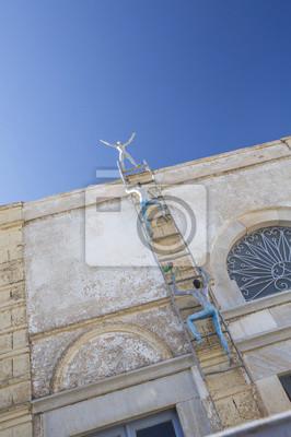 osób rzeźba wspinaczka na Santorini