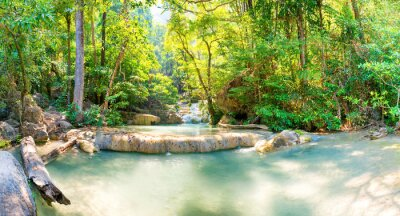 Panorama Tropical landscape with beautiful cascades of waterfall and green trees in wild jungle forest. Erawan National park, Kanchanaburi, Thailand