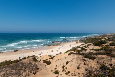 People at the Malhao Beach (Praia do Malhao) in Porto Covo, in Alentejo, Portugal.