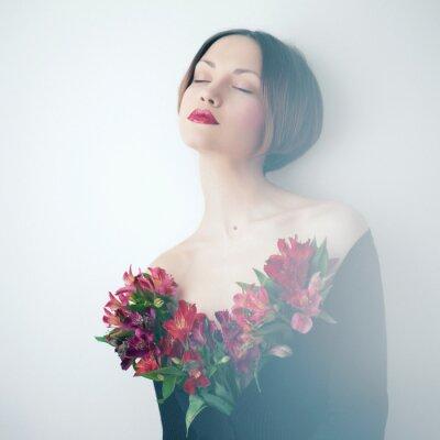 Obraz Piękna pani z kwiatami