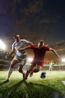 Obraz Piłkarzy w akcji na stadionie tle słońca