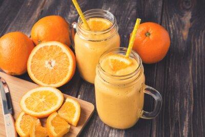 Obraz Pomarańczowy owoc smoothie w słoikach