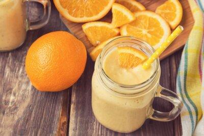 Obraz Pomarańczowy owoc smoothie w słoju