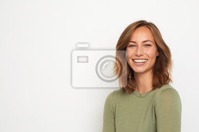 Obraz portrait of a young happy woman smiling on white background